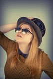 Cute Girl Tramp. Tramp girl wears old top hat in vintage photo style Stock Photos