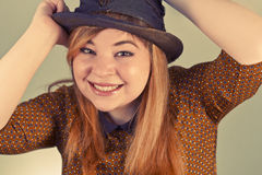 Cute Girl Tramp. Tramp girl wears old top hat in vintage photo style Stock Images