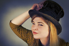 Cute Girl Tramp. Tramp girl wears old top hat in vintage photo style Stock Photo