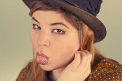 Cute Girl Tramp. Tramp girl wears old top hat in vintage photo style Royalty Free Stock Photo