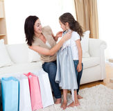 Cute girl trying on a dress with her mother Royalty Free Stock Image