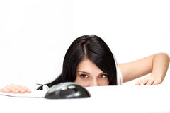 Cute girl trying to catch computer mouse Stock Photo