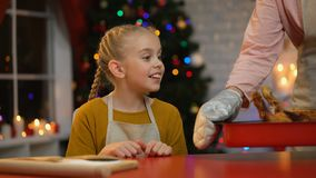 Cute girl trying to touch roasted chicken, granny does not allow her, Xmas eve. Stock footage stock video footage