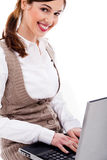 Cute girl typing on laptop Royalty Free Stock Image