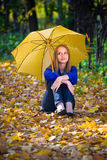 Cute girl with umbrella. At autumn stock photography