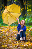 Cute girl with umbrella. At autumn stock photos