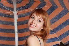 Cute girl under parasol Stock Photos