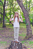 Cute girl with upwards hands Royalty Free Stock Photos