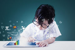 Cute girl uses tablet with formula Stock Image