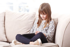 Cute girl with using digital tablet Stock Photography