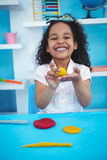 Cute girl using modeling clay Royalty Free Stock Images