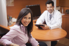 Cute girl visiting her doctor Stock Images