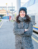 Cute girl waiting next to a train and smiling trough tears Royalty Free Stock Photos