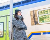 Cute girl waiting next to a train Stock Photos