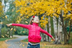 Cute girl walking in the autumn park Stock Image