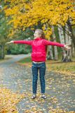 Cute girl walking in the autumn park Royalty Free Stock Photos