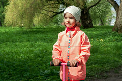 Cute girl is walking in a beautiful green park Stock Photography