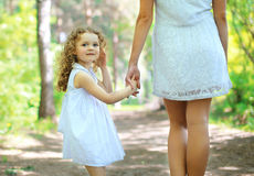 Cute girl walking with mom Royalty Free Stock Images