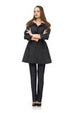Cute girl in warm dark coat isolated on white Royalty Free Stock Photos