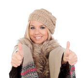 Cute girl with warm winter clothing saying Ok Royalty Free Stock Photography