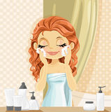 Cute girl washes facial wash in the bathroom Royalty Free Stock Images