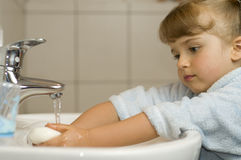 Cute girl washing hands Stock Photography