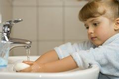 Cute girl washing hands Stock Photography