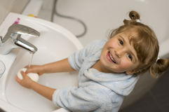 Cute girl washing hands Royalty Free Stock Photography