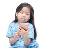 Cute girl watching on mobile phone Stock Photo