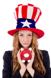 Cute girl wearing american symbol hat isolated on Royalty Free Stock Images