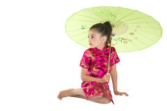 Cute girl wearing Asian dress sitting under umbrella Royalty Free Stock Images