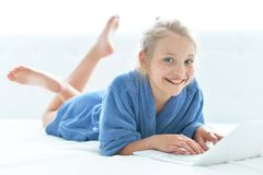 Cute girl wearing blue bathrobe royalty free stock photography