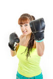 Cute girl wearing boxing gloves ready to fight and standing in c Royalty Free Stock Photo