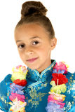 Cute girl wearing a Chinese dress and a lei smiling Royalty Free Stock Photos