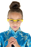 Cute girl wearing Chinese dress and yellow glasses Royalty Free Stock Image