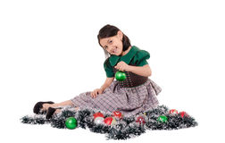 Cute girl wearing a green Christmas holiday dress Royalty Free Stock Images