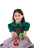 Cute girl wearing a green Christmas holiday dress Stock Images