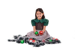 Cute girl wearing a green Christmas holiday dress Royalty Free Stock Photography