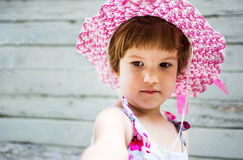 Cute girl wearing hat against vintage backdrop stock photography