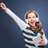 Cute girl wearing head phones shouting. Royalty Free Stock Images