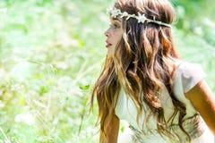 Cute girl wearing headband in field. Royalty Free Stock Photos