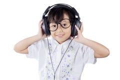 Cute girl wearing headphones in studio Royalty Free Stock Images