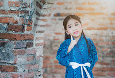 Cute girl wearing  National Costumes of japan. In park Stock Image
