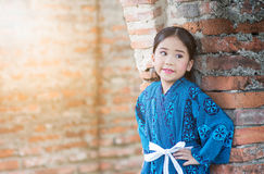 Cute girl wearing  National Costumes of japan. In park Stock Photos