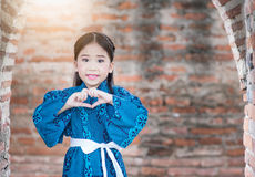 Cute girl wearing  National Costumes of japan. In park Stock Photography