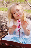 Cute girl wearing playing with flowers Stock Photos