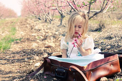 Cute girl wearing playing with flowers Royalty Free Stock Photography