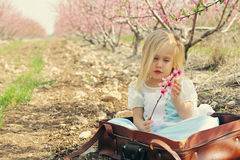 Cute girl wearing playing with flowers Stock Photo