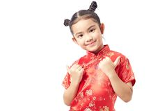 Cute girl wearing red Chinese suit. Cute Chinese Girl Dresses Welcome Chinese New Year Royalty Free Stock Images