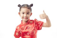 Cute girl wearing red Chinese suit. Cute Chinese Girl Dresses Welcome Chinese New Year Stock Images